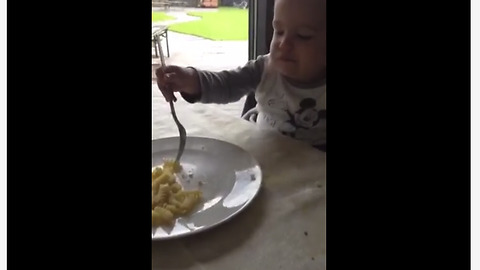 Toddler Takes Real Delight Into Munching Macaroni With Two Forks