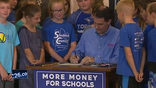Walker signs state budget - Video