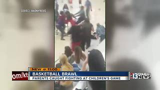 Adults fight during kid's basketball game - Video