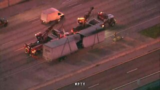 U.S. mail truck trailer nearly split in half on I-95 southbound in Lake Worth