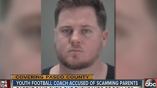 Youth football coach arrested on fraud charges - Video