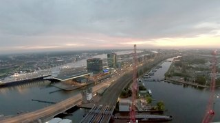 Heart-stopping moment daredevil climbs crane and is rewarded with breathtaking view