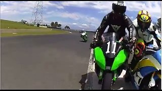 Moto GP racer gets a cheeky nudge off bike! - Video