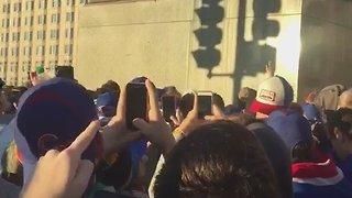 Chicago Cubs Fan Performs Trust Fall From Statue Into Arms of Waiting Fans Below - Video