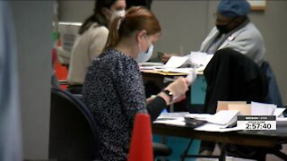 Counting record absentee ballots in Milwaukee