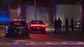 Man in custody after charging at Cleveland police with gun in hand