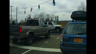 Jeep runs red stop light then truck narrowly misses hitting it