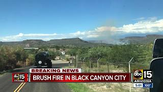 Crews battling brush fire near Black Canyon City - Video
