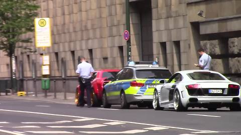 Exotic cars burnout through busy city streets, receive instant karma
