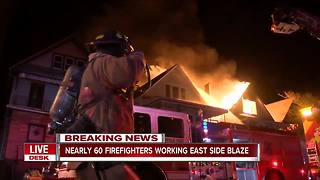 Seven people being helped by Red Cross after fire - Video