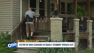 Man robbed by Akron accused murderer speaks out - Video