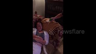 People hilariously prank sleeping friend - Video