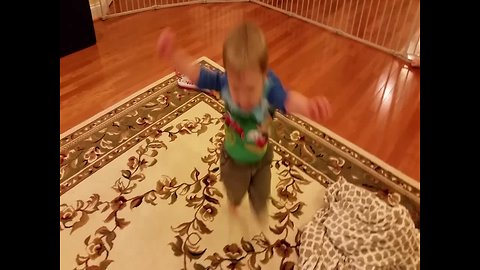 Determined Little Boy Learns how to Hop on One Foot