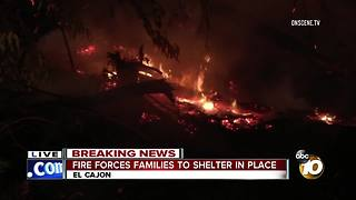 Fire forces families to shelter in place - Video