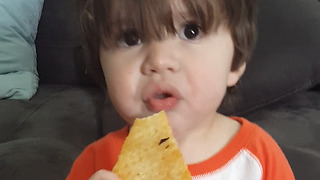 An Adorable Boy Steals A Pizza Slice