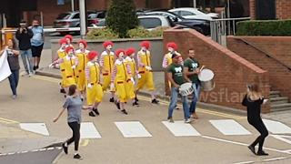 Clowns dance outside McDonald's UK headquarters in animal rights protest
