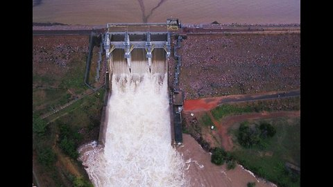 Drone Video Shows Floodwater Gushing Down Spillway as Dam Opens in Townsville