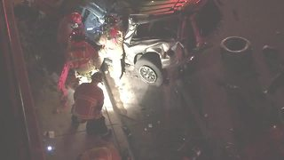 Fire crews rescue trapped motorist from crash - Video