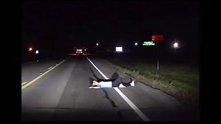 Stunning dashcam video shows intoxicated woman passed out in roadway - Video