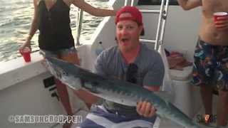 Man Trolls Friend With Barracuda on a Boat - Video