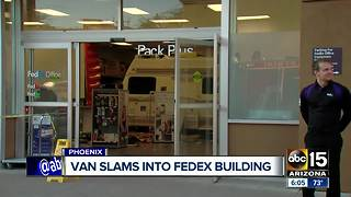 Van slams into FedEx building in Phoenix - Video