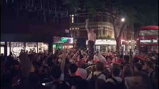Shirtless fan in London jumps atop car after last-16 win against Colombia - Video