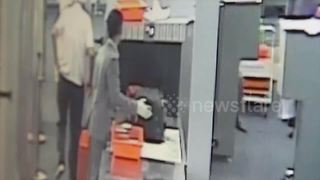Airport security guard caught stealing cash from 89-YEAR-OLD tourist - Video