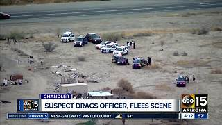 Officer injured after being dragged in Chandler - Video