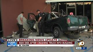 Man dies after crashing truck into building