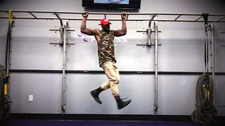 Bar jamming: Guy dances while hanging off pull-up bar