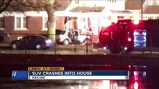 Driver, occupants injured after car crashes into Racine house
