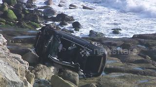 Car plunges off cliff in Dorset trapping driver inside - Video