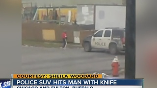 Police SUV hits man with knife - Video