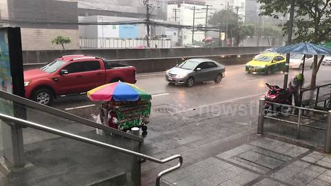 Heavy rain causes flooding and traffic chaos in Bangkok