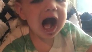 Baby argues that cold yogurt is hot - Video