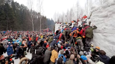 Picturesque russian holiday has celebrators fight over snowy fortress