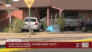 FD: Woman seriously injured after shooting, being in vehicle that crashed into Phoenix home