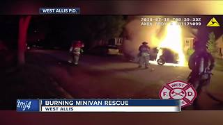 VIDEO: West Allis firefighters rescue person from a burning car