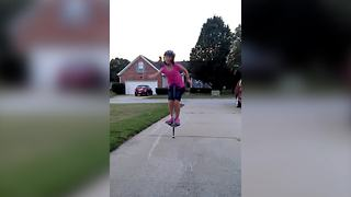 Young Girl Jumps On A Pogo Stick With No Hands - Video