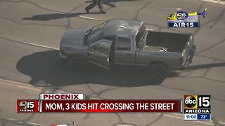 Mom, three kids by vehicle in Phoenix - Video