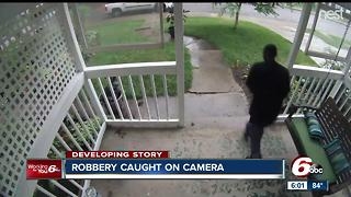 CAUGHT ON VIDEO: Porch Pirate brazely steals package from home on Indy's - Video