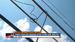 Neighbors worry about hanging cable lines in backyard after Hurricane Irma - Video