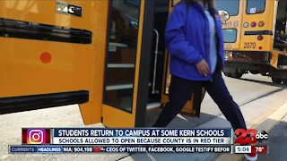 Some students head back to campus after months-long COVID disruption