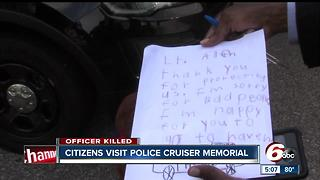 Citizens visit police cruiser memorial of Lt. Aaron Allan - Video