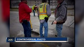 One fired, two suspended after armed workers photo surfaced - Video