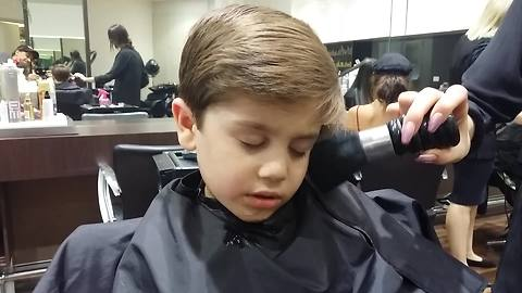 Adorable Kid Decides To Take A Nap During A Haircut