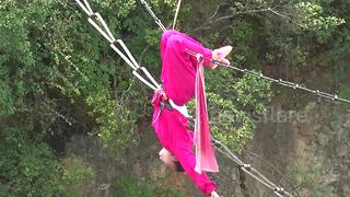 Father and daughter perform kung fu on tight rope over ravine - Video