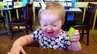 Baby eats lime... and loves it! - Video