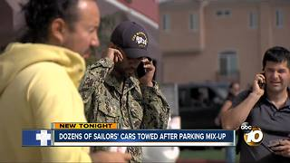Dozens of sailors' cars towed after parking mix-up - Video