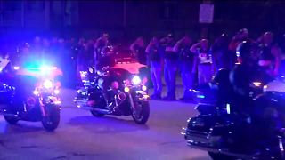 Police procession runs through downtown Milwaukee - Video